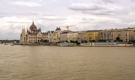 Budapest, Hungary-June 2019. Building of Budapest near the Danubio river in a cloudy day. You can see the city life.