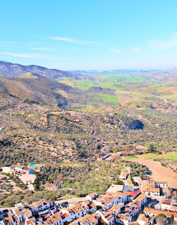 Aerial view of the Spanish city of Zahara de la Sierra in the south of Spain in a sunny day. It´s surrounded by mountains.