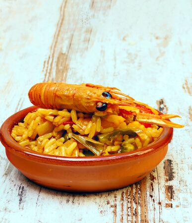 Spanish Paella surrounded by rustic background