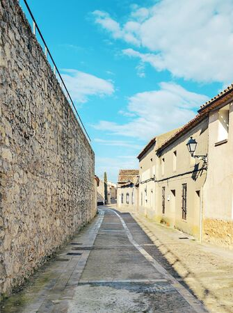 Street of town of Valladolid in the north of Spain in a cloudy day: It´s a medieval village. Stock Photo