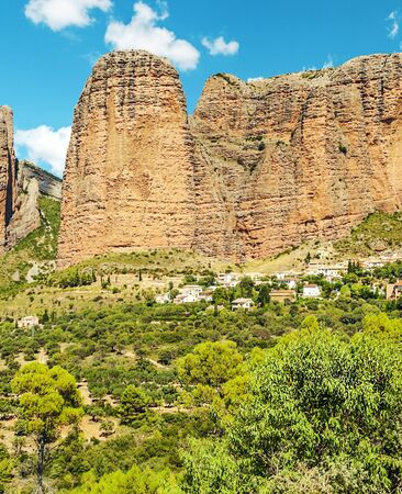 Mountains of Riglos in the Pyrenees mountains in the north of Spain in a sunny day Фото со стока
