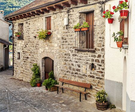 Street of Hechos village in the pyrenees mountains in a sunny day