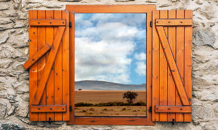 Landscape of Kenya in a cloudy day. Its a point of vies from a wood window.