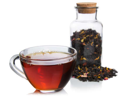 cup of tea: Isolated glass cup tea with tea jar