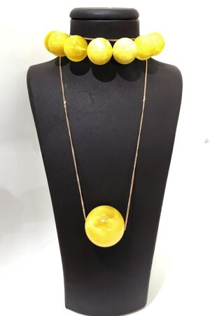Decorations from large round balls of white Baltic amber on a stand. For a jewelry store poster.