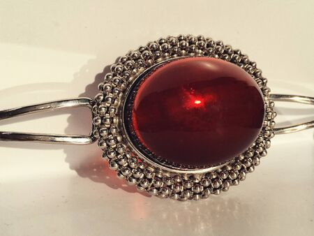 A bracelet with large red Mexican amber in a silver frame. Photo for decoration jewelry store. Imagens