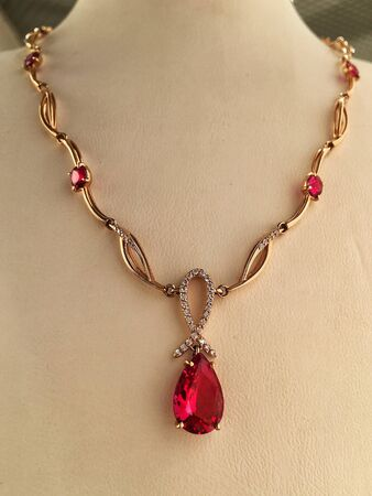 Gold ruby necklace on a jewelry stand. luxury jewelry.