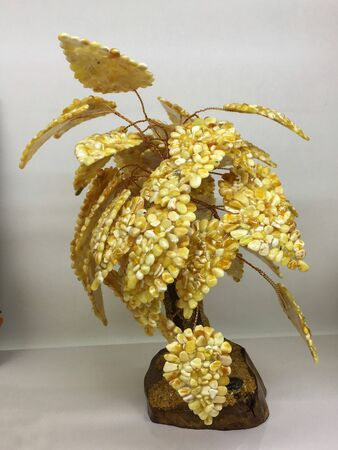 Handmade souvenir tree made of many small pieces of natural Baltic amber