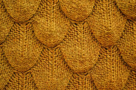 Realistic knitted texture closeup in orange brown . Fashionable cconcept. Stock Photo