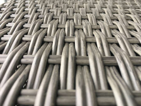Gray wicker texture closeup. Background for website design, screen, banner.