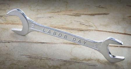 reliëf tekst dag van de arbeid op de moersleutel Stockfoto