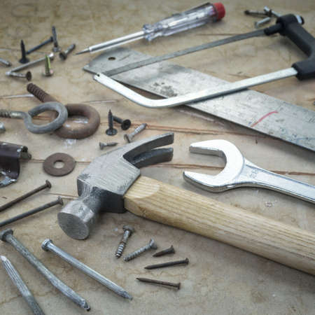 working tools on a board background photo