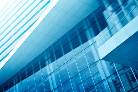 Light blue background of glass high rise building for business background