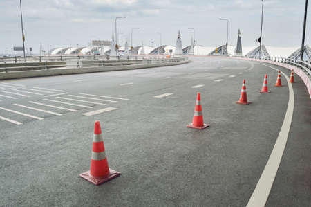 Traffic cone placed on the curving road in Bangkok, Thailand Reklamní fotografie