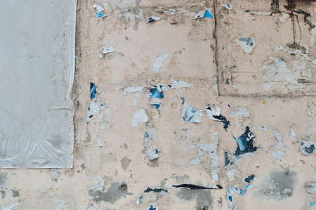 Grunge torn street billboard posters on wall background