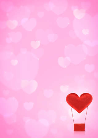 Red heart air balloon on pink heart bokeh background, love concept photo