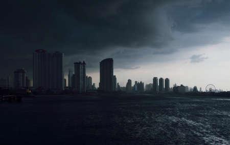 chao praya: Skyline of Chao Praya river with a dark stormy sky