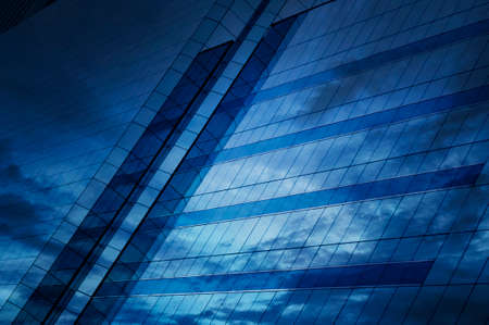Glass of modern tower for business background, dark tone
