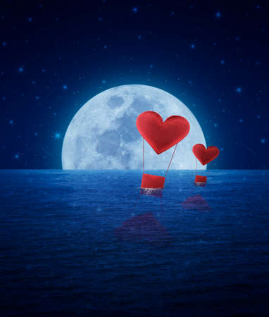 Red fabric heart air balloon on fantasy sea sky and moon, love concept photo