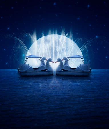 Swan pedal boat on fantasy sea sky fountain and moon night time, love concept photo