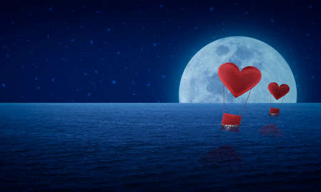 Red fabric heart air balloon on fantasy sea sky and moon, love concept