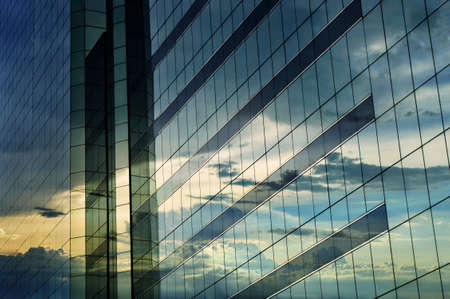 urban architecture: Glass of modern tower, sunset reflection