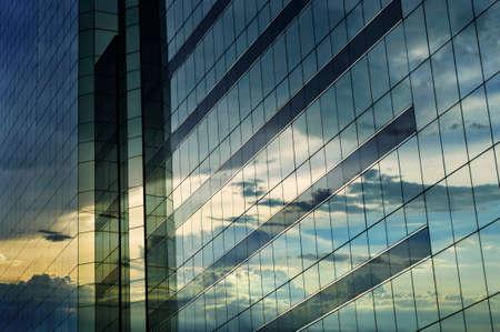 Glass of modern tower, sunset reflection