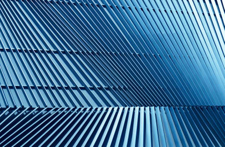 Detail of pattern metal facade for background, blue tone
