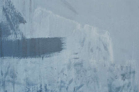 textured abstract paint stroke on blue wall