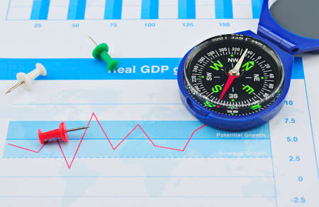 azimuth: Blue compass and red pin on graph paper, success concept Stock Photo