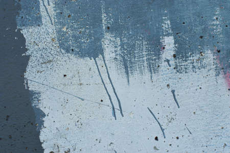 abstract paint: textured abstract paint stroke on blue wall