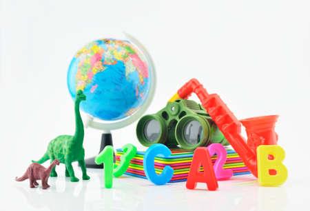 plastic toys: Colorful plastic toys on white background children explore concept