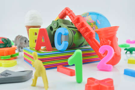 plastic toys: Colorful plastic toys on white background kid education concept