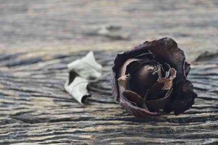 broken love: Dried Rose on old wooden background broken heart concept Stock Photo