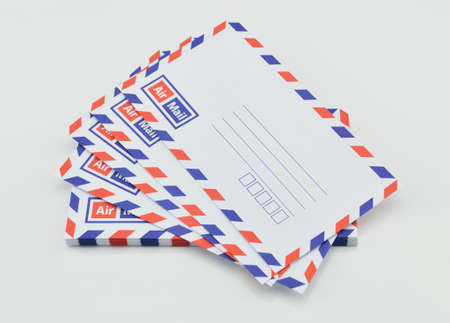 air mail: Stack of air mail envelopes on white background