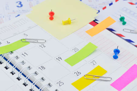 post it notes: Colorful post It notes with pin and clip on business diary page