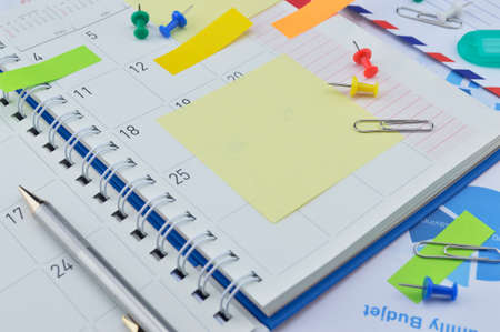 post it notes: Pen with colorful post It notes and pin on business diary page