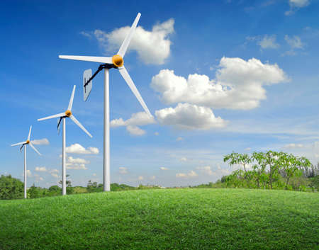 wind force wheel: Wind turbines on green meadow and sky Stock Photo