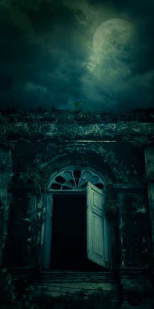 night moon: Spooky ancient window building with full moon, Halloween background Stock Photo