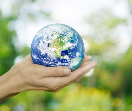 Earth in hands on green bokeh background, Environment concept