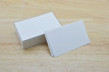 namecard: Blank business card with box on wooden office table