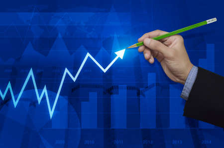 map pencil: Businessman hand pointing pencil to arrow business graph over map and city background, Elements of this image furnished by NASA