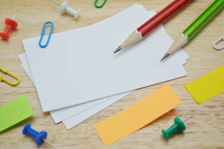 namecard: Namecard, pencil, clip and sticky notes on wooden table