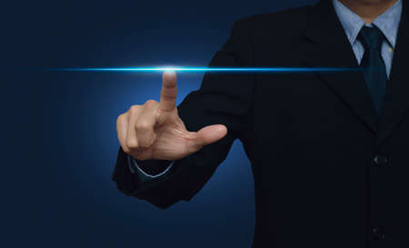 Businessman hand pressing power light over blue background, internet and networking concept