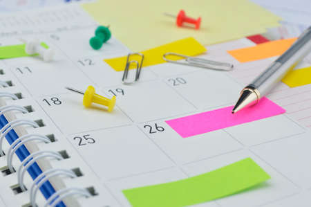 Pencil with colorful sticky notes and pin on business diary page 스톡 콘텐츠