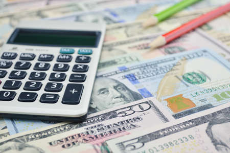 bank note: Calculator and pencil on dollar bank note money, Finance concept Stock Photo