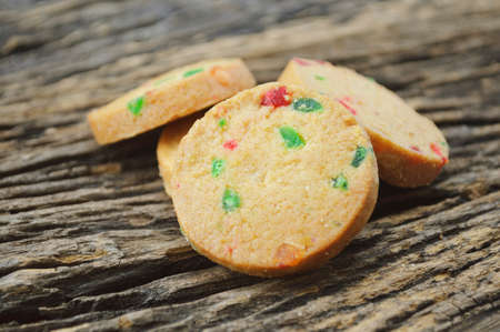mixed fruits: Mixed fruits cookies on old wooden background Stock Photo