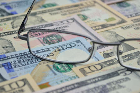 bank note: Glasses and dollar bank note money; financial concept
