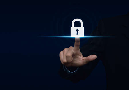Businessman pressing security button icon, Technology information security and data encryption concept Stockfoto