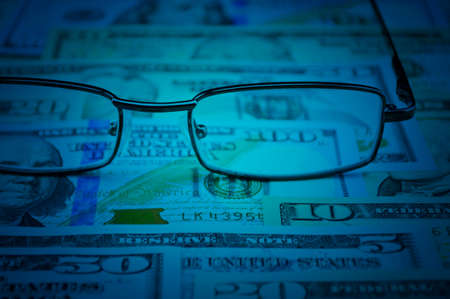 visions of america: Glasses on dollar money, financial and business concept Stock Photo